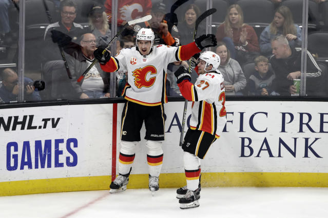 Calgary Flames' Mikael Backlund, left, celebrates his goal with Austin Czarnik (27) during the third period of an NHL hockey game against the Anaheim Ducks Sunday, Oct. 20, 2019, in Anaheim, Calif. (AP Photo/Marcio Jose Sanchez)