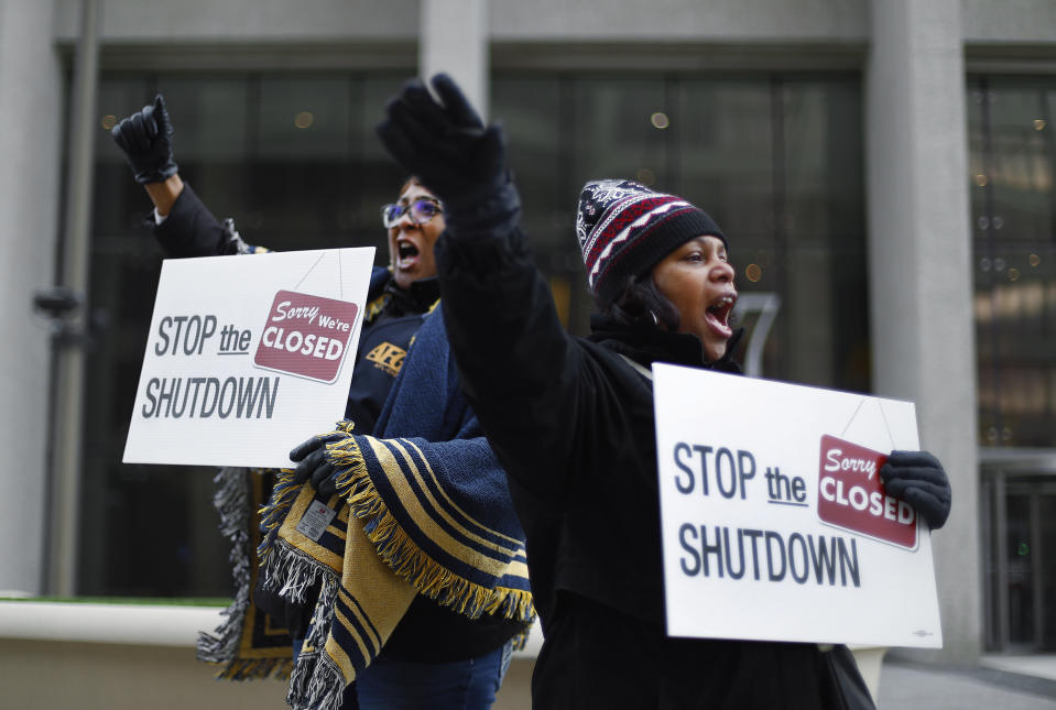 Cheryl Monroe, right, a Food and Drug Administration employee, and Bertrice Sanders, a Social Security Administration employee, rally to call for an end to the partial government shutdown in Detroit, Thursday, Jan. 10, 2019. (Photo: Paul Sancya/AP)