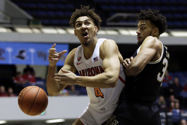 Arizona center Chase Jeter, left, loses the ball going to the basket against Wake Forest center Olivier Sarr, right, during the first half of an NCAA college basketball game at the Wooden Legacy tournament in Anaheim, Calif., Sunday, Dec. 1, 2019. (AP Photo/Alex Gallar,o)