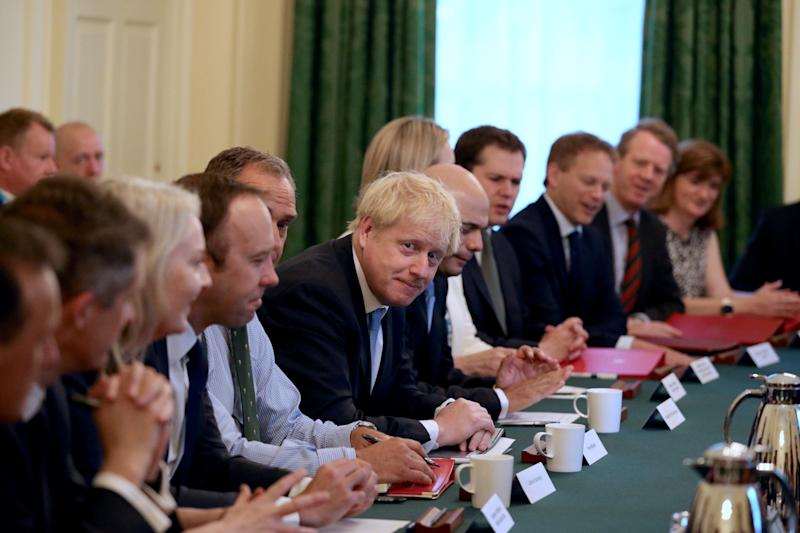 Prime Minister Boris Johnson holds his first Cabinet meeting at Downing Street in London.