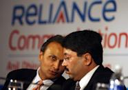 Chairman of Reliance Anil Dhirubhai Ambani Group, Anil Ambani (L) chats with Indian Minister of Communications and IT Dayanidhi Maran (R) at the launch of the FALCON Submarine Cable system in New Delhi, 05 September 2006. Reliance Communications owned Falcon with its undersea cable connecting five Middle East countries as well as Sudan and Egypt, announced commercial operation of the cable after Union IT and Communications Minister Dayanidhi Maran made the first call, unleashing international bandwidth between India, Middle East and Europe. The 2.56 terabit FALCON submarine cable system will connect 11 countries on its entire length of 11,859 km from Mumbai to Egypt. AFP PHOTO/Prakash SINGH