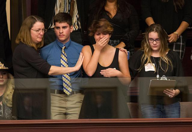 <p>Sheryl Acquarola, a 16 year-old junior from Marjory Stoneman Douglas High School is overcome with emotion in the east gallery of the House of Representatives after the representatives voted not to hear the bill banning assault rifles and large capacity magazines at the Florida Capital in Tallahassee, Fla., Feb 20, 2018. Acquarola was one of the survivors of the Marjory Stoneman Douglas High School shooting that left 17 dead, who were in Tallahassee channeling their anger and sadness into action. (Photo: Mark Wallheiser/AP) </p>