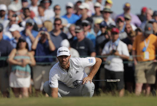 Dustin Johnson lines up a putt on the 13th green during the final round of the U.S. Open Golf Championship, Sunday, June 17, 2018, in Southampton, N.Y. (AP Photo/Frank Franklin II)