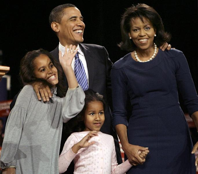 FILE - In this Jan. 3, 2008, file photo, then-Democratic presidential hopeful Sen. Barack Obama, D-Ill., waves to supporters at an after caucus rally in Des Moines, Iowa, after winning the Iowa democratic presidential caucus. He is joined by his wife Michelle and daughters Sasha and Malia. For President Barack Obama, it's ending where it all began. Obama will close his 2012 campaign with a nighttime rally in Iowa, where his 2008 caucus victory jumpstarted his road to the White House. The president is expected to reflect back on the state's pivotal role in his political rise during remarks delivered at the site of his first Iowa campaign headquarters. (AP Photo/M. Spencer Green, File)