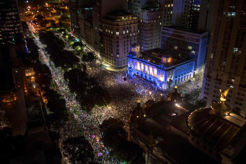 Thousands of protestors gathered outside the city council chamber (AFP)