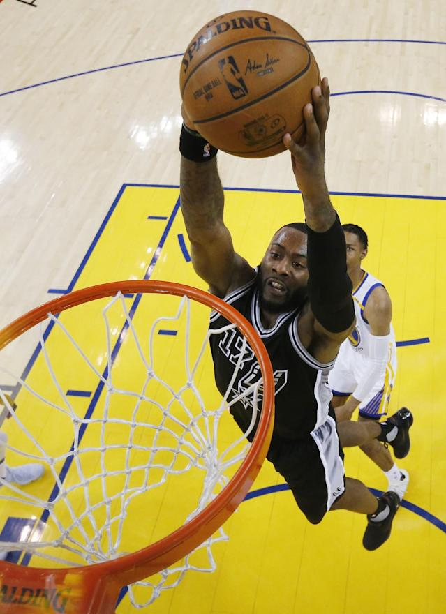 <p>San Antonio Spurs' Jonathon Simmons (17) dunks against the Golden State Warriors during the first half of Game 2 of the NBA basketball Western Conference finals, Tuesday, May 16, 2017, in Oakland, Calif. (AP Photo/Marcio Jose Sanchez) </p>