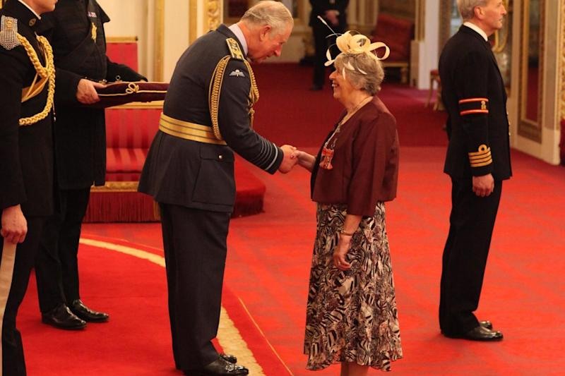 Chris Meadows receives an MBE from Prince Charles: PA