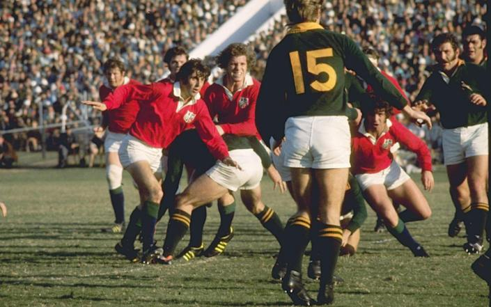 Ian McGeechan of the British Lions (left) in action against South Africa in 1974 - GETTY IMAGES