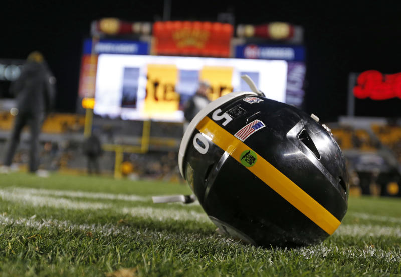 The helmet of Pittsburgh Steelers inside linebacker Ryan Shazier sits on the field after Sunday night's game. (AP)