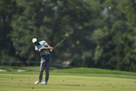 Tiger Woods shoots 8-under 62 in first round of BMW Championship