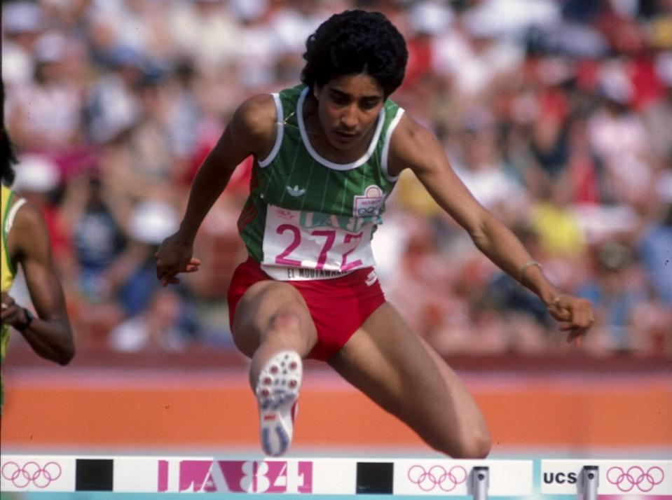 Nawal El Moutawakel of Morocco clears a hurdle during the inaugural Women's 400 metres hurdles event at the XXIII Olympic Summer Games on 8th August 1984 at the Los Angeles Memorial Coliseum in Los Angeles, California, United States. (Photo by Tony Duffy/Allsport/Getty Images)