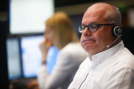 A trader reacts at his desk at the Frankfurt stock exchange