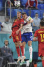 Belgium's Timothy Castagne, left, and Russia's Artem Dzyuba challenge for the ball during the Euro 2020 soccer championship group B match between Russia and Belgium at Gazprom arena stadium in St. Petersburg, Russia, Saturday, June 12, 2021. (AP Photo/Kirill Kudryavtsev, Pool)