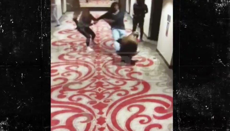 Video of Kansas City Chiefs running back Kareem Hunt shoving and kicking a young woman at a Cleveland hotel in February was published by TMZ on Friday. (Screengrab)