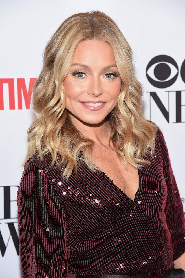 """<p>Kelly Ripa is arguably in the best shape of her life at age 49. The <em>Live with Kelly and Ryan </em>host's<em></em> biceps are ridiculous, her skin is all glowy...and have you seen her abs?! Not to mention, she can bust out a full dance routine on command and still get en pointe like a prima ballerina. Kelly's super fit body didn't just happen by accident. She puts in regular sweat sessions with her personal trainer and BFF Anna Kaiser (who also trains Shakira, FYI), in addition to taking SoulCycle classes. She doesn't just hustle in the gym, either. The longtime morning show host is also careful about her diet. She tried the alkaline diet in 2015 and hasn't looked back since, filling her plate with veggies and other high alkaline foods (she also says she's mostly plant-based these days).  She claims the diet helps fight inflammation, which she calls one of the """"great killers of people."""" Kelly also <a href=""""https://www.womenshealthmag.com/health/a31019269/why-did-kelly-ripa-quit-drinking/"""" target=""""_blank"""">gave up drinking alcohol</a> after realizing that she felt better sans booze during a """"sober month"""" she did with her girlfriends. Still, Kelly doesn't take herself or her healthy routine too seriously (have you seen her Instagram Stories?!). Here's how Kelly looks *so* amazing, plus the many health tricks she swears by.<br></p>"""