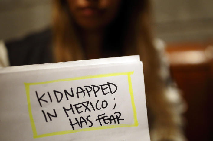 FILE - Lizbeth holds paperwork from her asylum case in a relative's home, Tuesday, Nov. 5, 2019, in Tijuana, Mexico. Lizbeth, a Salvadoran woman seeking asylum in the United States, never thought she would be returned to Mexico to wait for the outcome of her case, after suffering multiple assaults and being kidnapped into prostitution on her journey through Mexico. As President Joe Biden undoes his predecessor's immigration policies that he considers inhumane, he faces a major question: How far should he go to right perceived wrongs? (AP Photo/Gregory Bull, File)