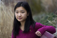 High school student Grace Hu, 16, of Sharon, Mass., stands for a photograph near Sharon High School, Sunday, April 11, 2021, in Sharon. Hu, who plans to to go back to in-person classes in April, helped organize a rally in Boston in early April against anti-Asian hate, but said she's not concerned about facing vitriol when her school reopens fully. The district, located about 27 miles south of Boston, has a sizable Asian student population and has felt generally safe and welcoming to her. (AP Photo/Steven Senne)