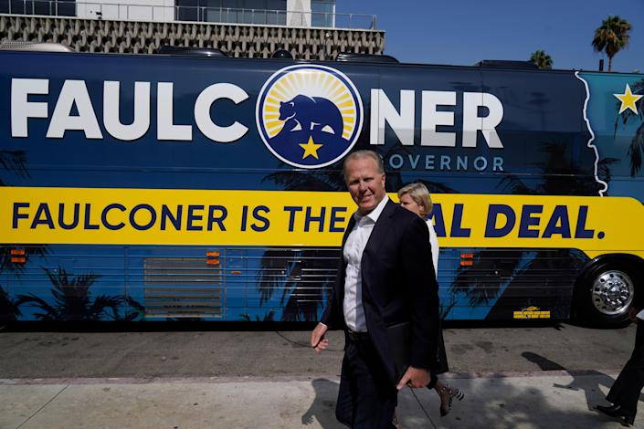 California gubernatorial candidate and former San Diego mayor Kevin Faulconer and his wife, Katherine Faulconer, arrive on a charter bus at a campaign stop to promote his