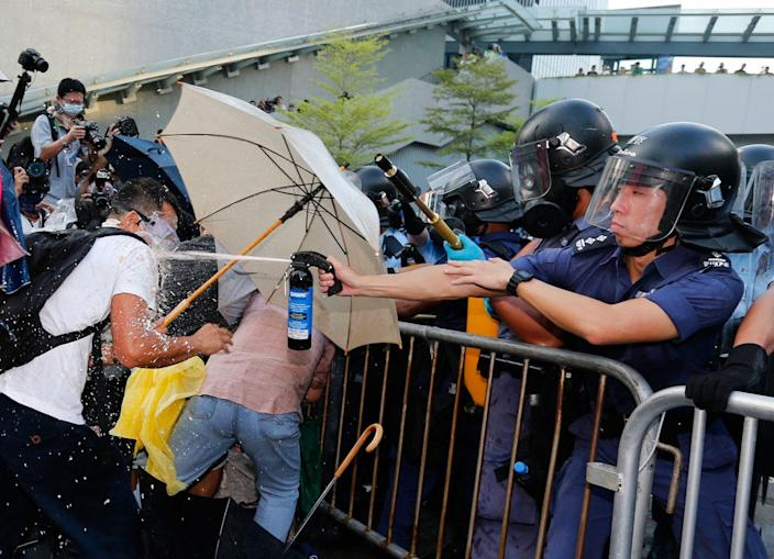 Hong Kong police spray protesters with pepper spray, September 2014.