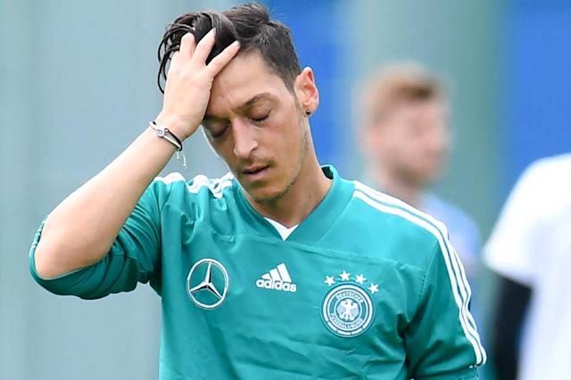 Germany's midfielder Mesut Ozil is one of several 2014 World Cup winners under intense pressure to keep their place for Saturday's crucial match against Sweden on Saturday in Group F which the Germans must win to be sure of staying in the tournament. (AFP Photo/Patrik STOLLARZ)