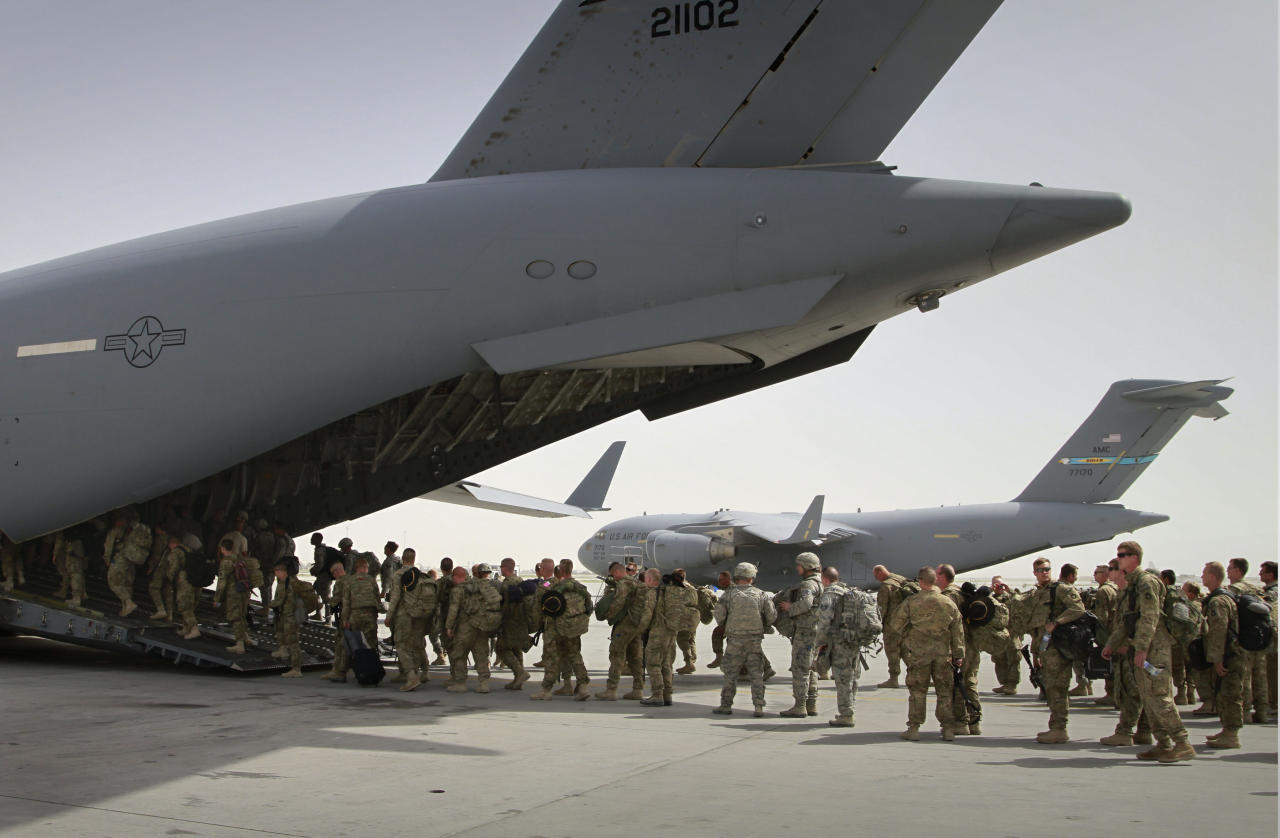 FILE -- In this Thursday, July 14, 2011 file photo, U.S. soldiers board a U.S. military plane, as they leave Afghanistan, at the U.S. base in Bagram north of Kabul, Afghanistan. The United States is not alone in pulling combat troops off the Afghan battlefield. More than a dozen other countries have draw down plans that combined with the U.S. withdrawal will shrink the foreign military footprint in Afghanistan by more than 40,000 troops by the close of next year. (AP Photo/Musadeq Sadeq, File)