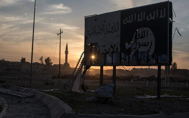Billboard displaying the ISIS logo in the neighbourhood of Sammod, on the southern edge of western Mosul - Credit: Sam Tarling for the Telegraph
