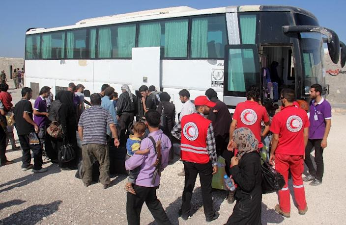 Hundreds of fighters from Daraya and their families were bused north into rebel-held territory in Idlib province (AFP Photo/Omar haj kadour)