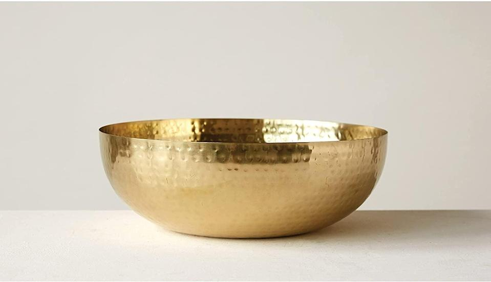 <p>Whether you use this <span>Creative Co-Op Round Hammered Metal Bowl</span> ($27) to serve salads or hold your keys, it will enhance whatever surface you place it on. We especially love the brass finish and compact size.</p>