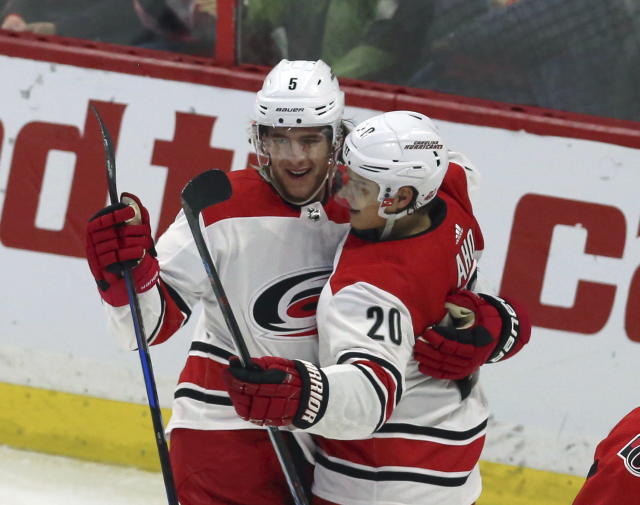 Carolina Hurricanes' Noah Hanifin (5) celebrates his goal against the Ottawa Senators with teammate Sebastian Aho (20) during third-period NHL hockey game action in Ottawa, Ontario, Saturday, March 24, 2018. (Fred Chartrand/The Canadian Press via AP)