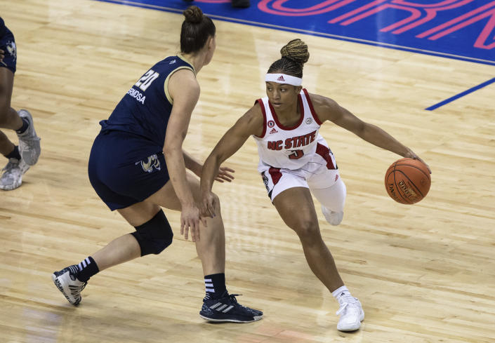 North Carolina State's Kai Crutchfield (3) handles the ball as Georgia Tech's Nerea Hermosa (20) defends during an NCAA college basketball game in the semifinals of Atlantic Coast Conference tournament in Greensboro, N.C., Saturday, March 6, 2021. (AP Photo/Ben McKeown)