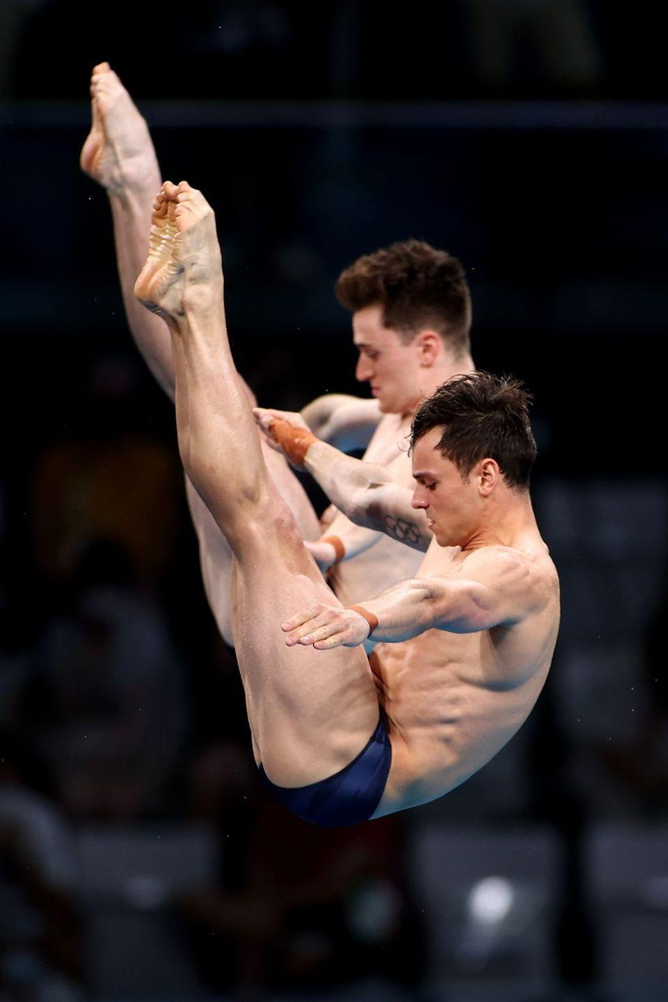 <p>English divers Tom Daley and Matty Lee perform a synchronized 10-meter platform event. The duo took home the gold for this competition.</p>