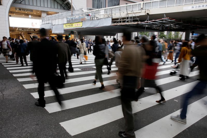 FILE PHOTO: Commuters pictured at a pedestrian crossing in Osaka