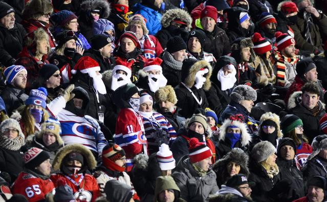 <p>Fans from both sides rock Santa Claus beards and hats while huddling together to stay warm during Ottawa's 3-0 victory. </p>