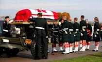 Soldiers adjust the coffin during the funeral procession for Cpl. Nathan Cirillo in Hamilton, Ontario October 28, 2014. REUTERS/Mark Blinch