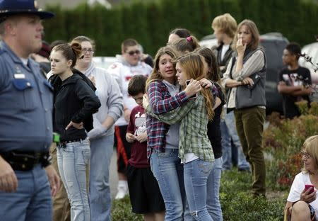 Two girls hug at Shoultes Gospel Hall church where families are reuniting after an active shooter situation at Marysville-Pilchuck High School in Marysville, Washington, October 24, 2014.     REUTERS/Jason Redmond