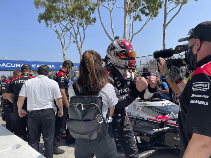 American driver Josef Newgarden celebrates after winning the pole for the Grand Prix of Long Beach, Saturday, Sept. 25, 2021, in Long Beach, Calif. The Sunday race on the downtown street circuit will crown the IndyCar champion and Newgarden sits third in the standings, behind leader Alex Palou of Spain and Pato O'Ward of Mexico. (AP Photo/Jenna Fryer)