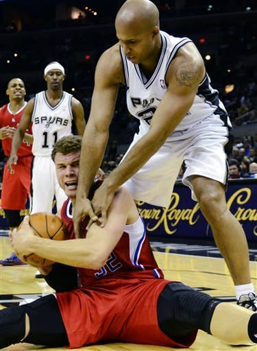 San Antonio Spurs forward Richard Jefferson battles Los Angeles Clippers forward Blake Griffin for possession of the ball as Griffin tries to call timeout during the first half of an NBA basketball game in San Antonio, Wednesday, Dec. 28, 2011. The Spurs won 115-90. (AP Photo/Bahram Mark Sobhani)