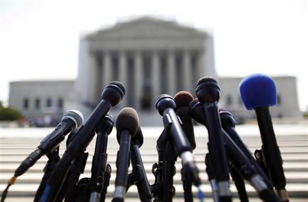 News microphones wait to capture reactions from U.S. Supreme Court rulings outside the court building in Washington