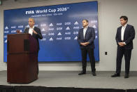 Colin Smith, FIFA Chief Tournaments & Events Officer, answers a question during a press conference Friday afternoon, Sept. 17, 2021 at Mercedes-Benz Stadium in Atlanta, as Victor Montagliani, FIFA vice-president and CONCACAF president, center, and Dan Corso, president of Atlanta Sports Council listen. Officials were touring the stadium as part of the FIFA World Cup 2026 Candidate Host City Tour. (AP Photo/Ben Gray)