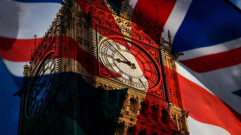union jack flag and iconic Big Ben at the palace of Westminster, London