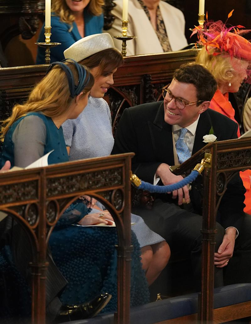 Princess Beatrice (left), Princess Eugenie and Jack Brooksbank take their seats at St George's Chapel at Windsor Castle before the wedding of Prince Harry to Meghan Markle on May 19, 2018 in Windsor, England.