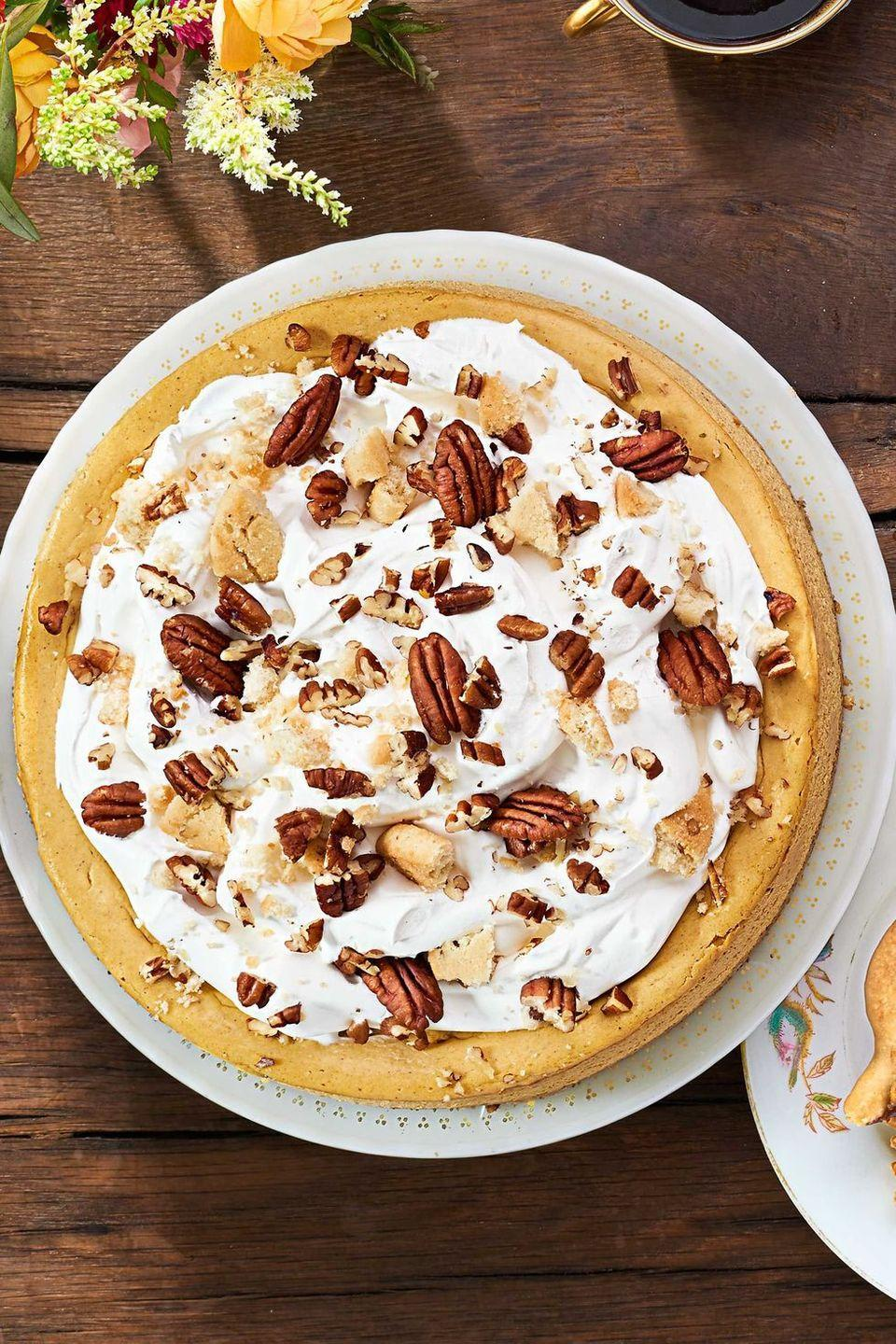 "<p>When it comes to dessert, there should be no compromises. That's why pumpkin cheesecakes exist. This showstopper is garnished with homemade pumpkin spice cookies, too. So yeah, safe to say everyone's happy.</p><p><em><a href=""https://www.countryliving.com/food-drinks/recipes/a40037/pumpkin-cheesecake-with-cookie-crust-recipe/"" rel=""nofollow noopener"" target=""_blank"" data-ylk=""slk:Get the recipe from Country Living »"" class=""link rapid-noclick-resp"">Get the recipe from Country Living »</a></em></p><p><strong>RELATED: </strong><a href=""https://www.goodhousekeeping.com/food-recipes/dessert/g4454/pumpkin-cheesecake-recipes/"" rel=""nofollow noopener"" target=""_blank"" data-ylk=""slk:22 Easy Pumpkin Cheesecake Recipes to Make This Fall"" class=""link rapid-noclick-resp"">22 Easy Pumpkin Cheesecake Recipes to Make This Fall</a><br></p>"