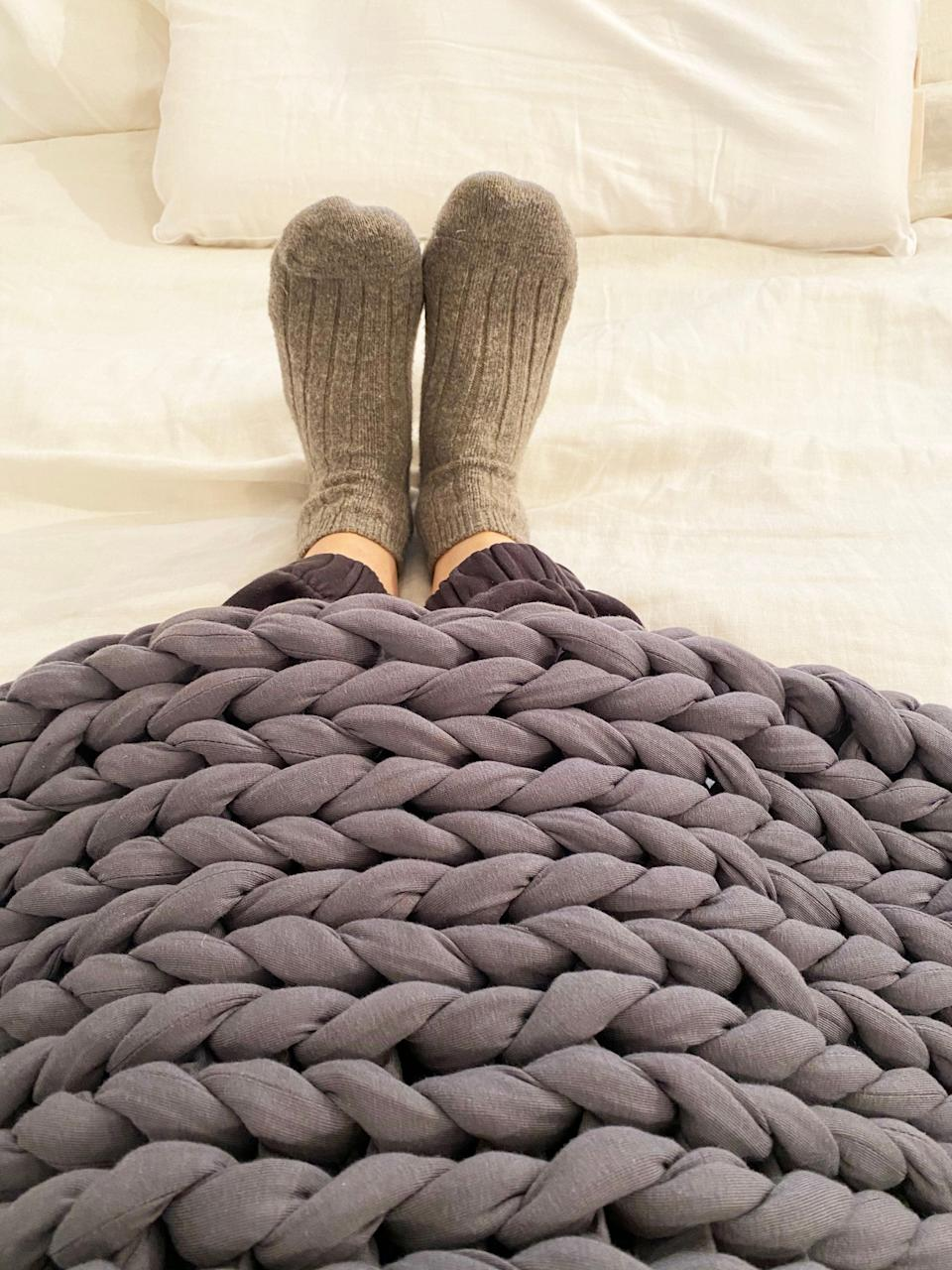 """<strong>What it actually did:</strong> Helped me feel more comfortable and less restless. <br><br><strong>What it didn't do:</strong> Help me fall asleep faster. <br><br><strong>My bedtime story: </strong>I was skeptical about this one, I know so many people have weighted blankets and love them but I've never understood the appeal — until I got my hands on one of my very own. It's kind of a game-changer and feels like a giant hug. I'm a person with 24/7 achy muscles and can never seem to find a comfortable sleeping position. The slight pressure from this 15lb blanket felt soothing and supportive, my body was able to settle much easier, and I was much less restless throughout the night. <br><br><strong>Who it's best for: </strong>Uneasy sleepers who need help settling their bodies to snooze. <br><br><strong>Bearaby</strong> The Napper (15lbs), $, available at <a href=""""https://go.skimresources.com/?id=30283X879131&url=https%3A%2F%2Fbearaby.com%2Fproducts%2Fthe-napper"""" rel=""""nofollow noopener"""" target=""""_blank"""" data-ylk=""""slk:Bearaby"""" class=""""link rapid-noclick-resp"""">Bearaby</a>"""