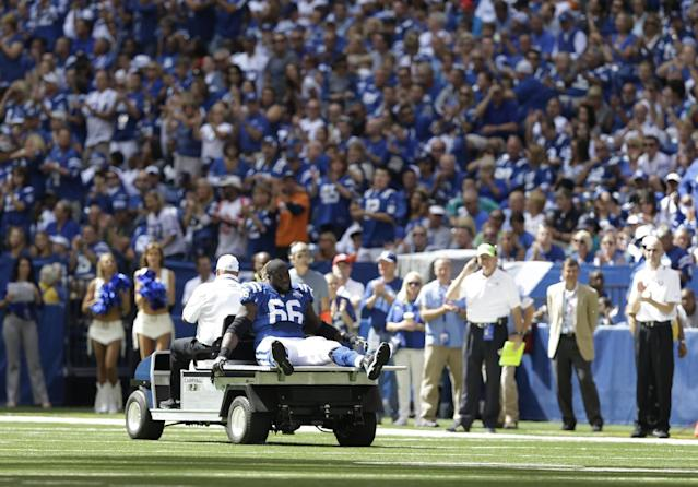 Indianapolis Colts' Donald Thomas (66) is carted off the field after getting injured during the first half an NFL football game against the Miami Dolphins Sunday, Sept. 15, 2013, in Indianapolis. (AP Photo/Michael Conroy)