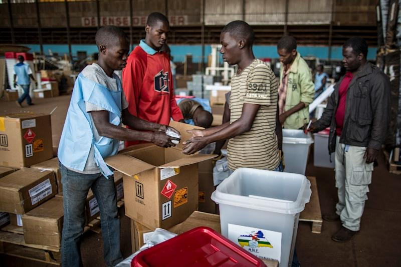 Electoral Commission employees prepare election material at the M'Poko International Airport in Bangui on December 11, 2015 ahead of the constitutional referendum earlier this month (AFP Photo/Marco Longari)
