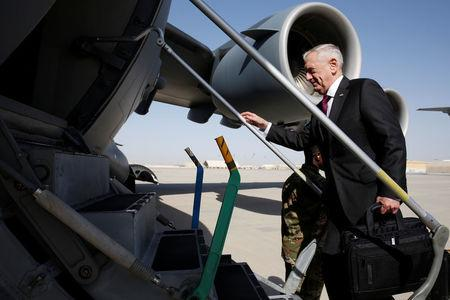 Mattis boards a U.S. Air Force C-17 for a day trip to a U.S. military base in Djibouti from Doha