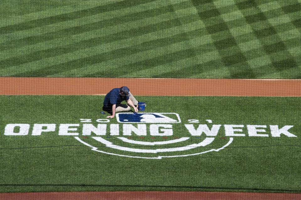 UNITED STATES - MARCH 30: A worker paints the MLB logo of the field during a media tour of Nationals Park ahead of Major League Baseball Opening Day to explain the health and safety protocols implemented due to the ongoing coronavirus pandemic on Tuesday, March 30, 2021. (Photo By Tom Williams/CQ-Roll Call, Inc via Getty Images)