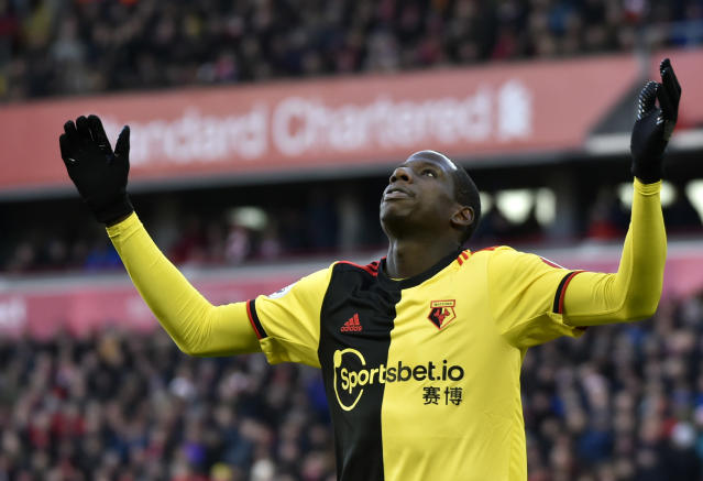Watford's Abdoulaye Doucoure gestures after missing a chance to score during the English Premier League soccer match between Liverpool and Watford at Anfield stadium in Liverpool, England, Saturday, Dec. 14, 2019. (AP Photo/Rui Vieira)