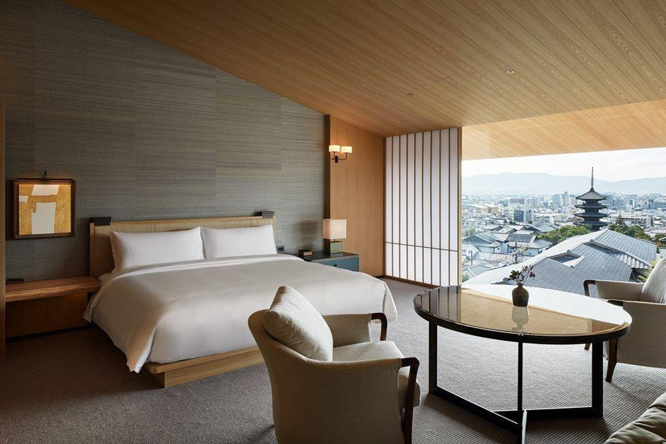 <p><strong>Why did this hotel catch your attention? What's the vibe?</strong> A compact, Jenga-like structure built cleverly into the maze of Kyoto's temple-dense Higashiyama ward.</p> <p><strong>What's the backstory?</strong> The structure is a partnership of the Pritzker, Takenaka (a 17th-generation construction family responsible for many of Japan's temples), and Kyoyamato families, with Tony Chi as interior designer.</p> <p><strong>Tell us all about the accommodations. Any tips on what to book?</strong> I stayed in the Higashiyama House suite, an airy 970-square-foot penthouse with sloped tamo wood ceilings and floor-to-ceiling windows offering sweeping views of Higashiyama and the Yasaka Pagoda. The king-sized bed was spacious and extremely comfortable, and the bathroom had a circular two-person marble tub stocked with Japanese bath salts and double sinks. Furniture included two modern, heather gray wingback reading chairs with lamps, wicker ottomans, and beautiful wooden shelves and tables.</p> <p><strong>Is there a charge for Wi-Fi?</strong> No, Wi-Fi was free and fine.</p> <p><strong>Drinking and dining—what are we looking at?</strong> The five food and beverage spots are highlights. Yasaka is the Japanese teppanyaki restaurant, with modern takes on grilled wagyu and seasonal Japanese vegetables. Pair it with a glass from Kyoto's Tamba winery or a Japanese chardonnay. Kyoyamoto, Kyoto's famed Japanese kaiseki restaurant, has been around long before the hotel and is worth visiting even if you are not spending the night. Expect an ornate presentation of seasonal dishes in exquisite plates, which the restaurant has such a big collection of that they have to keep it in a storage facility. Kyoto Bistro is the casual, contemporary café with its own entrance, making it a neighborhood favorite. It holds its own food-wise with steaks, gratins, and salads, though for visitors seeking Japanese classics, this may not be the best bet. The Living Room is a lounge space wh