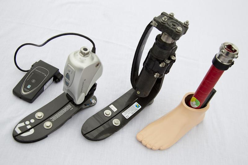 FILE - From left, a microprocessor controlled ankle/foot prosthetic, a shock foot vertical loading pylon prosthetic and a flexible keel foot prosthetic, are displayed at the Orthotic Prosthetic Center in Fairfax, Va. on Wednesday, Feb. 8, 2012. More than 200 were injured in the Boston Marathon bombings and no one knows yet what the total medical costs will be. (AP Photo/Carolyn Kaster)
